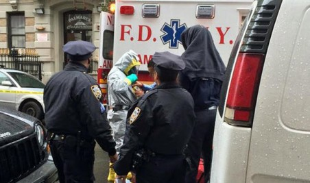 A doctor who returned to New York City from Africa 10 days ago was rushed in an ambulance with a police escort from his Harlem home to Bellevue Hospital on Thursday, sources said.